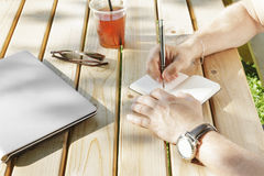 Young man writes in his notebook Stock Images
