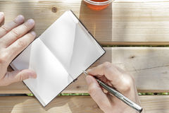 Young man writes in his notebook Stock Photo