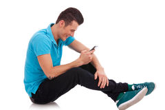 Young man writes an sms Royalty Free Stock Photos