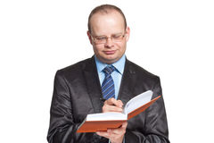 Young man writes something in the diary Royalty Free Stock Image