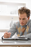 Young man writing Stock Image