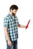 Young man writing with big red pencil. Royalty Free Stock Image