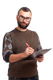 Young man writing on a clipboard Royalty Free Stock Image
