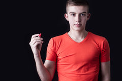 Young man writing or drawing to the blank space Stock Image