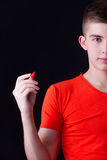 Young man writing or drawing to the blank space Stock Photo