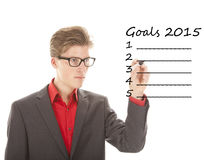 Young man writing goals 2015 isolated Stock Photos