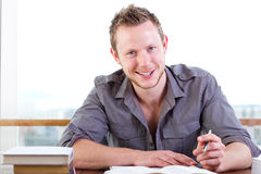 Young man writing a letter Royalty Free Stock Photos