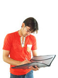 Young Man Writing Notes Stock Image