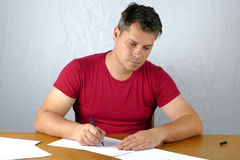 Young man writing Royalty Free Stock Image