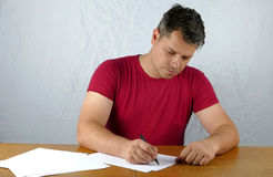 Young man writing Stock Photo