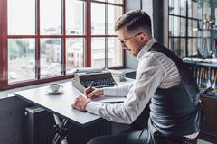 Young man writing the screenwriter royalty free stock images