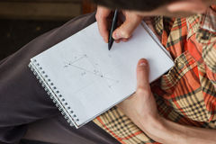 The young man wrote mathematical formulas Royalty Free Stock Photo
