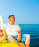 Young man on the yacht. Royalty Free Stock Photos