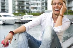 Young man at a yacht club Stock Photo