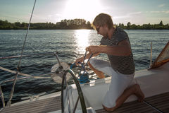 Young man on a yacht Stock Photos