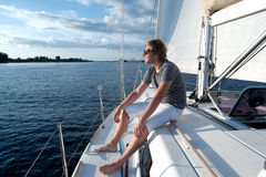 Young man on a yacht Royalty Free Stock Image