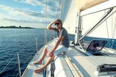 Young man on a yacht Stock Images