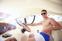 Young man on yacht royalty free stock images