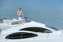 Young man on yacht Royalty Free Stock Image