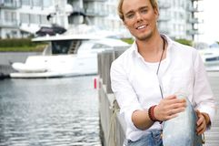 Young man at a yachtclub Royalty Free Stock Photography