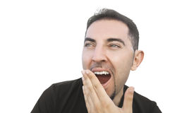 Young man yawning. Stock Images