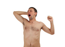 Young man yawning and stretching Stock Photography