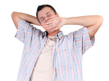 young man yawning and stretching Stock Images