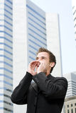 Young man yelling downtown Stock Photo