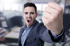 Yelling with his fist in the foreground Stock Photo