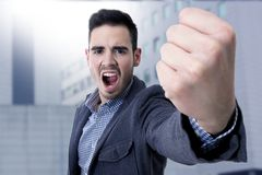 Yelling with his fist in the foreground Stock Photos