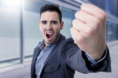 Yelling with his fist in the foreground Royalty Free Stock Photo