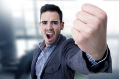 Yelling with his fist in the foreground Royalty Free Stock Images