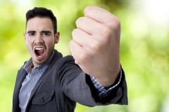 Yelling with his fist in the foreground Royalty Free Stock Photos