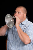 Young Man Yelling Through A Metal Horn Stock Photography