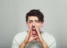 Young man yelling Royalty Free Stock Image
