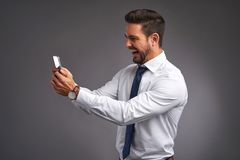 Young man yelling to his phone Royalty Free Stock Image