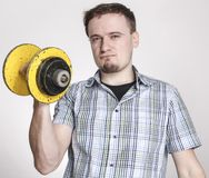 Young man with yellow barbell Stock Photography