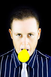 Young man with yellow bulb in his mouth Stock Image