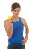 Young man with yellow lightbulb Stock Photos