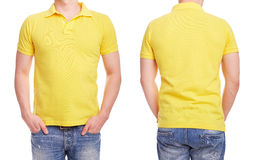 Young man with yellow polo shirt. On a white background Stock Image