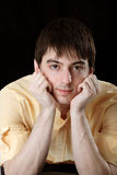 Young man in yellow shirt Royalty Free Stock Images