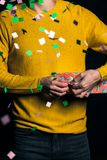 Young man in yellow sweater hold presents royalty free stock photos