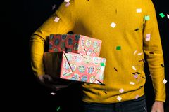Young man in yellow sweater hold presents royalty free stock images