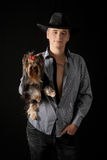 Young man  with Yorkshire terrier. Stock Photos