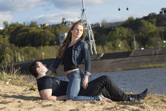 Young man with young woman looking aside Royalty Free Stock Photos