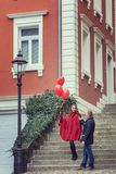 A young man and a young woman with red accessories. Love story. A young men and a young women with red accessories are walking in the city Royalty Free Stock Photography