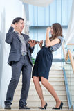 A young man and young woman standing on the stairs Stock Photo