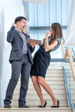 A young man and young woman standing on the stairs  Stock Photos
