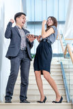 A young man and young woman standing on the stairs Royalty Free Stock Images