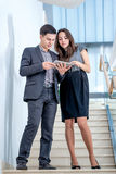 A young man and young woman standing on the stairs  Stock Photography
